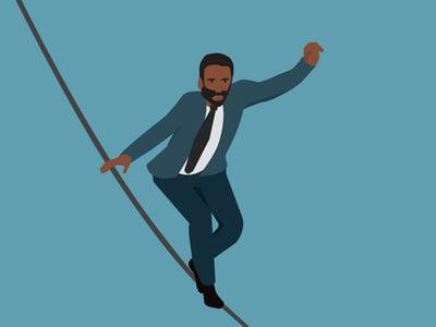 Man balancing on a tightrope.