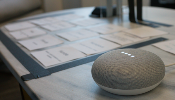google home mini with personality trait cards in background