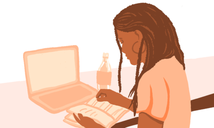 Woman working at desk with notebook, laptop, and water bottle