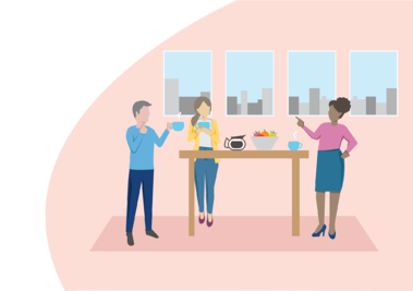 Three people gathering around the table drinking coffee in the office