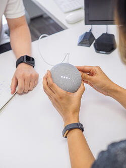 interacting with a google home mini in the lab