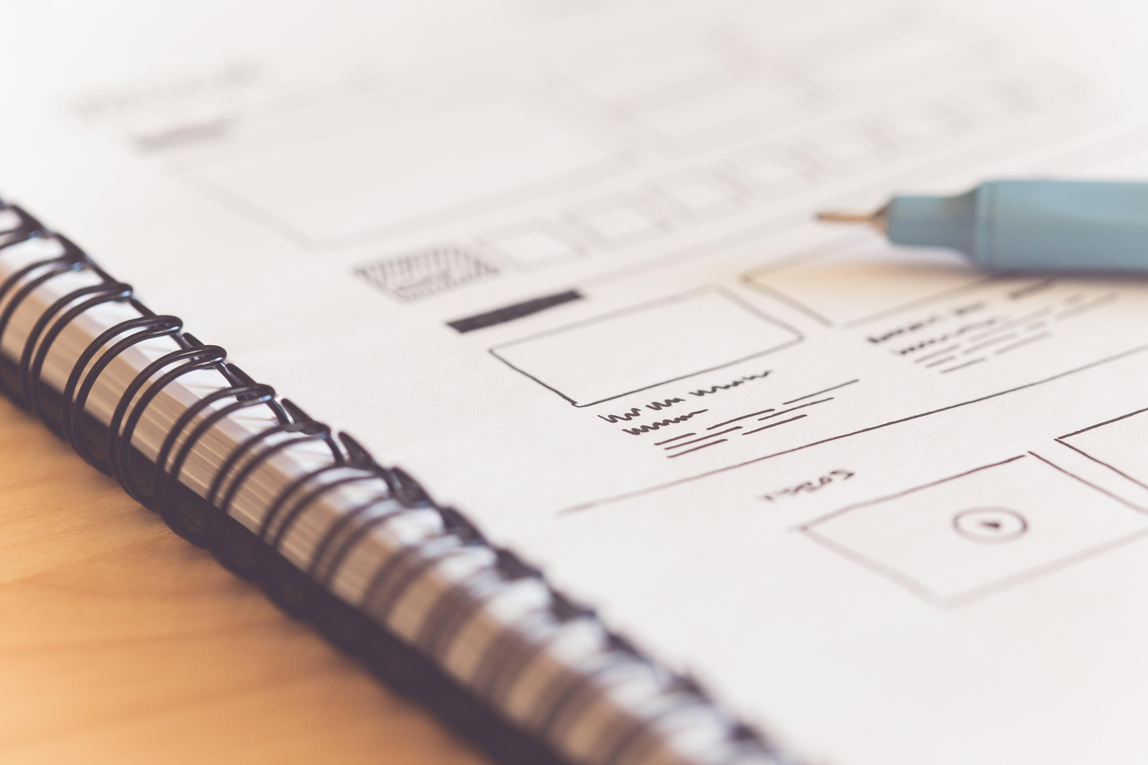 sketching-startup-website-ideas-on-paper-picjumbo-com.jpg