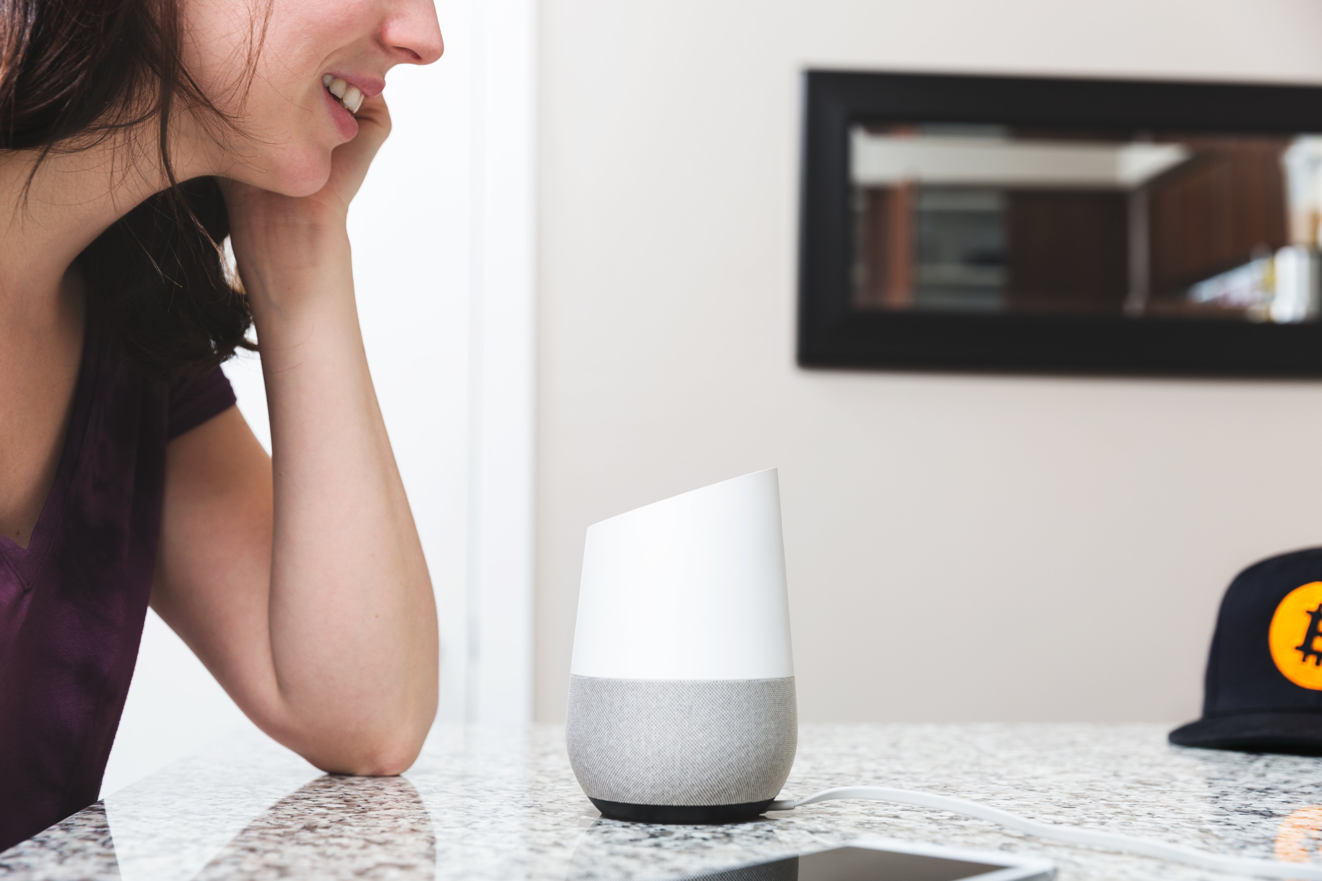woman talking to google home