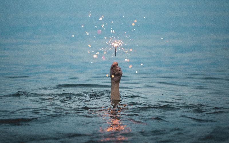 Fist holding sparkler