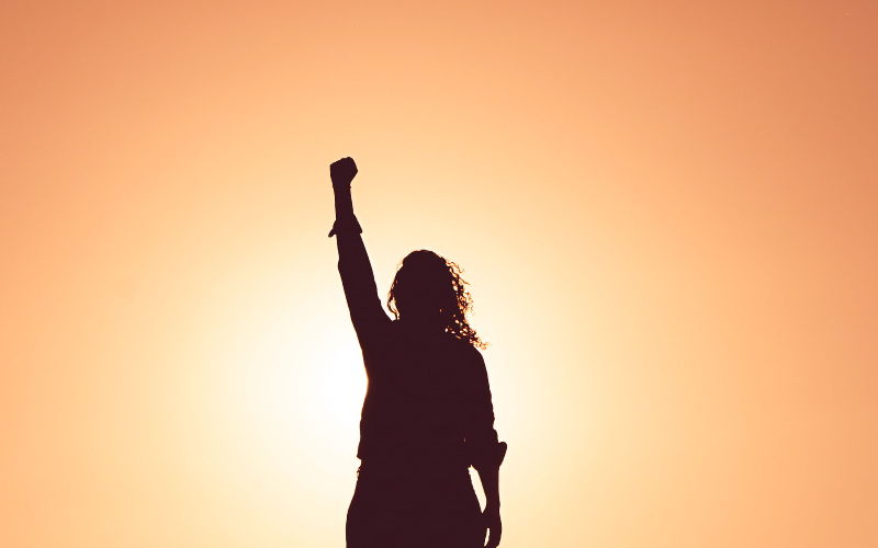 Woman raising her fist in the sky