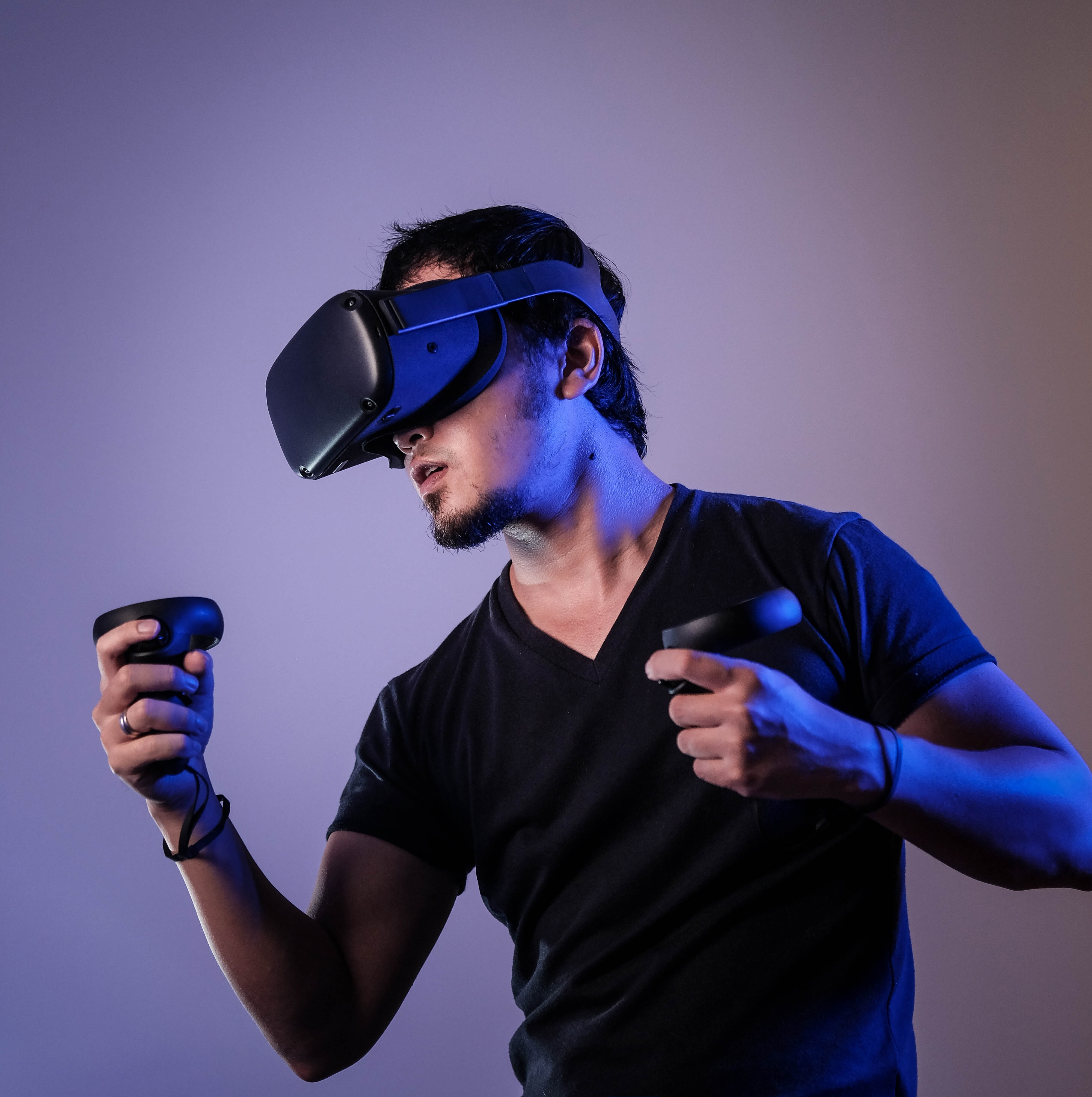 Man wearing a VR headset and holding controllers