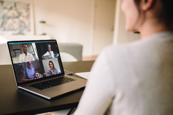 Woman on video call with four participants