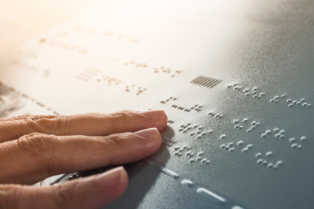 person reading braille-2